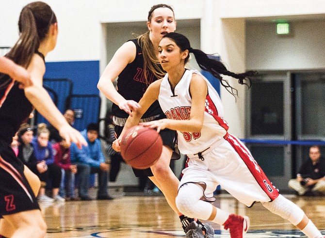 Granger's Jayleen Vasquez drives past a Zillah defender during the district championship game two weeks ago.