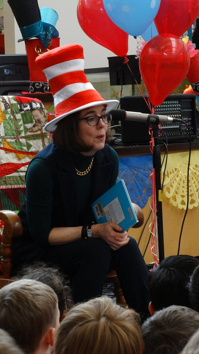 """Gov. Kate Brown reads Dr. Seuss' """"A Great Day for Up"""" Thursday to students at Ash Creek Elementary School, part of the National Education Association's Read Across America day."""