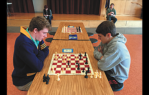 Chad Klaas of Hood River, left, competes against The Dalles High School freshman Noah Holloran in a chess match Feb. 25 at the Chess for Success regional chess tournament, held at The Dalles Middle School.
