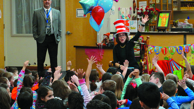 Gov. Kate Brown reads to Ash Creek Elementary School students on Thursday's Read Across America kickoff.