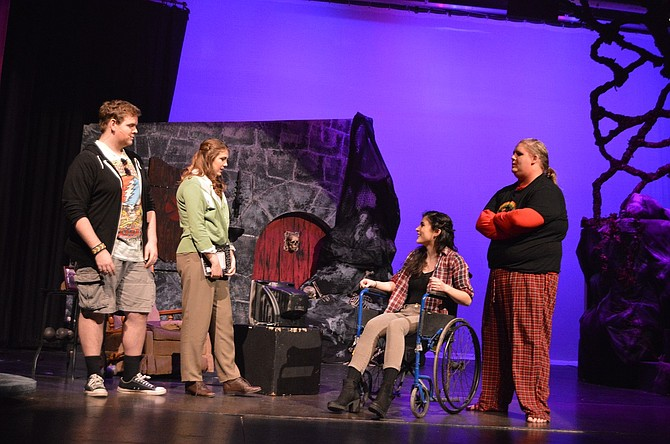 "Dungeon Master Chuck (Thomas Lovejoy) introduces Agnes (Savannah Rogan) to the real-life Kaliope (Lucy Fine) and Orcus (Aiden Tappert) in ""She Kills Monsters,"" playing this weekend and next at Hood River Valley High School."