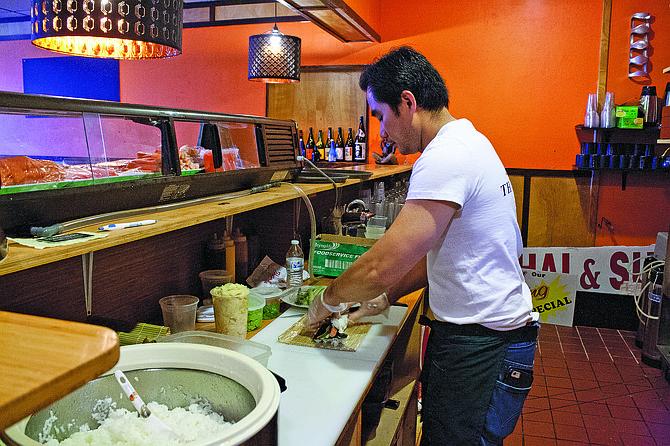 Zen owner Montree Navan prepares sushi on Monday. Zen Thai & Sushi opened Feb. 24.
