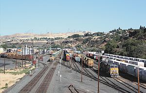 A westbound Union Pacific freight train idles on the mainline (left) in The Dalles while waiting for the single-track near Mosier to clear. UP's proposed $42 million siding extension project near Mosier is geared to reduce the time trains need to spend waiting to get through the area.