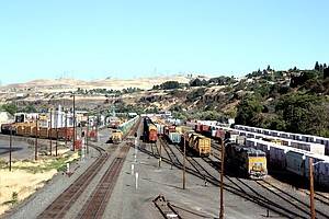 A UNION PACIFIC freight train idles on the mainline (left) in The Dalles while waiting for the single-track near Mosier to clear. UP's proposed $42 million siding extension project near Mosier is geared to reduce the time trains need to spend waiting to get through the area.