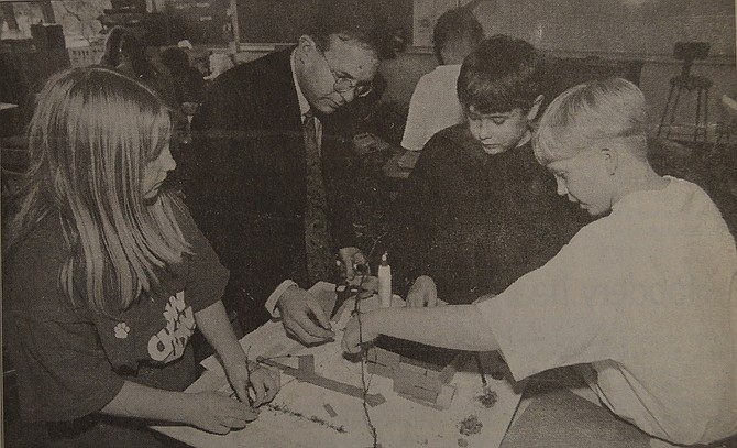 March 19, 1997 — Helping to lay the groundwork for the new Hood River County animal shelter are these May Street Elementary School students and the project's architect, Carl Perron. Pictured from left are Laura Kahler, Perron, Blair Geil and Brent Clair.