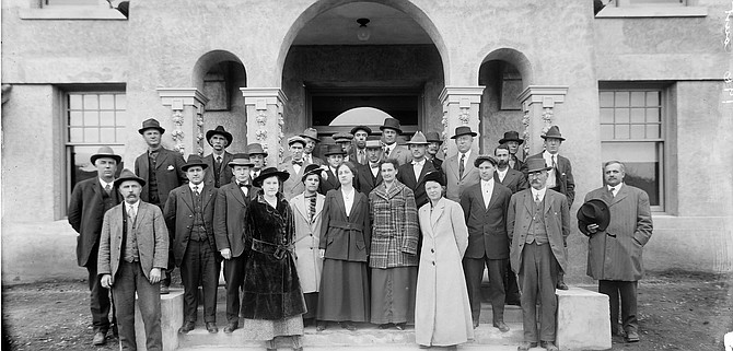 Okanogan County officials assemble outside the newly built courthouse in Okanogan in 1915. By the early years of the last century, women were holding official positions in government.