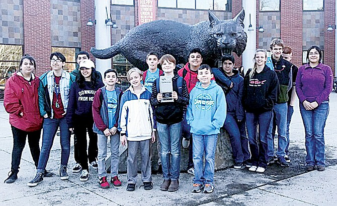 The Harrison Robotics Club, standing with the Sunnyside High School Robotics club, shows its state award qualifying four members to compete in the world finals next month in Kentucky.