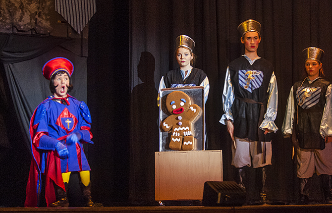 Lord Farquaad (Felix Brantner), left, interrogates the gingerbread man as to the whereabouts of Princess Fiona (Stephanie Ligamarri-Kunz) in Farquaad's quest to become king during a dress rehearsal at The Dalles High School Wednesday night.