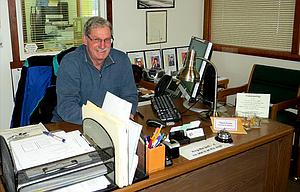 Mark Fortin mans the front desk at the Wasco County Veterans' Service Office and urges others to volunteer and serve area military families.