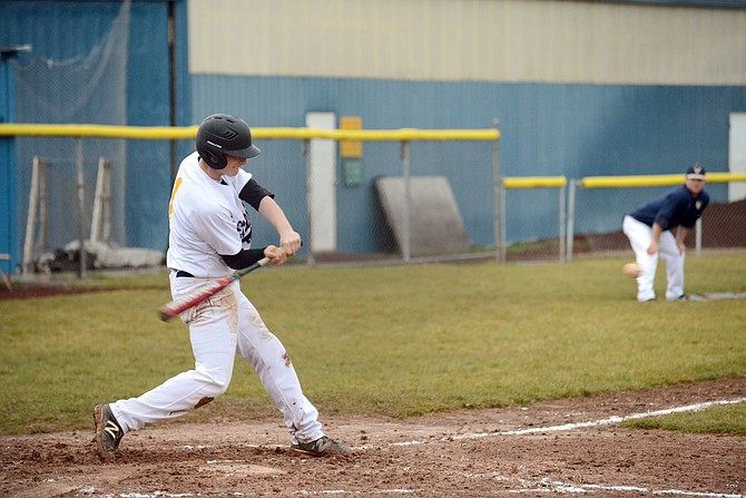 HRV BASEBALL began on a high note this season, pummeling Gresham 8-1 in the Eagles' home-opener that was played in The Dalles Tuesday due to the weather. Above, Caden Leiblein starts his swing in the game against Barlow.