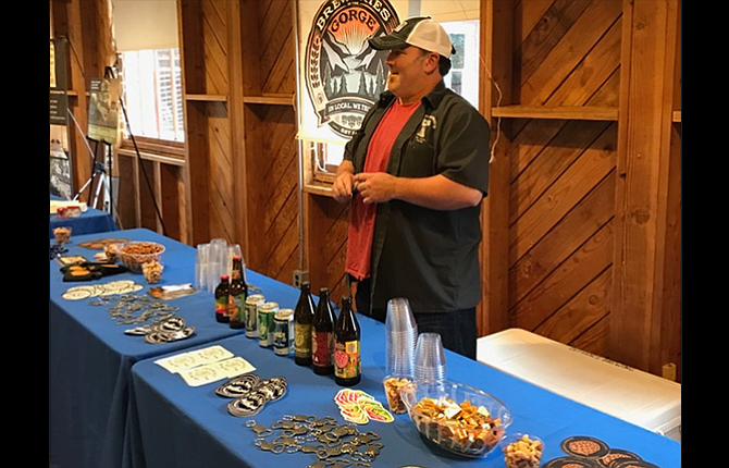 Aaron Lee stands ready to serve about 150 legislators and visitors at Mission Mill in Salem at the March 9 Gorge(ous) Night Out reception that was sponsored by several Republican officials from Wasco and Hood River counties.