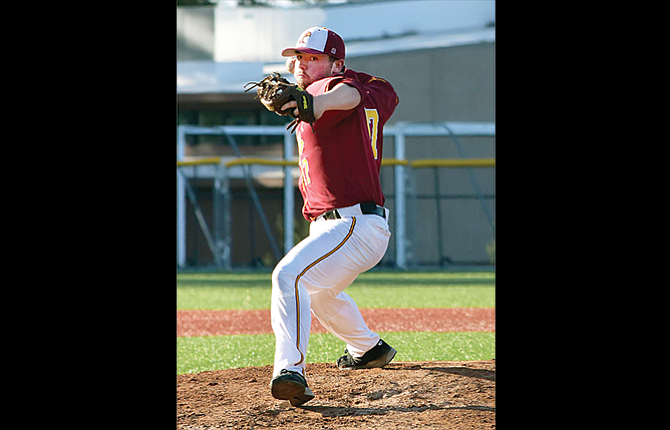 The Dalles pitcher Tyler Westin winds up for a pitch in Thursday's road game at Sandy. The Hawks stranded 11 runners in their 4-3 setback.