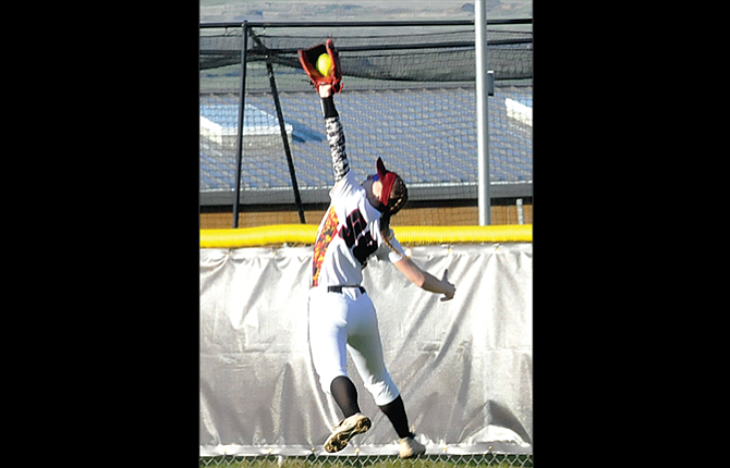 The Dalles centerfielder Kathryn Bradford makes an acrobatic catch to stop a rally in Thursday's game versus Liberty at 16th Street Ballpark. TD lost, 6-4.