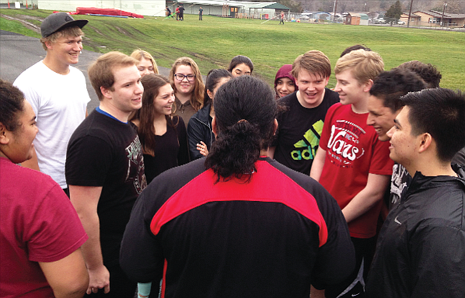 The Dalles coach Jermaine Hisatake gathers his field events group together for a few moments during practice Wednesday at Sid White Field. The Riverhawk track and field team boasts a roster of 94 athletes that are looking to show enough progression for district success and state qualification.