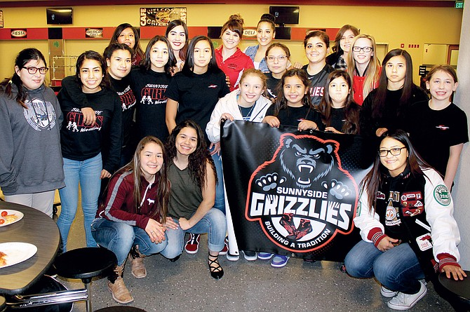 The Sunnyside Grizzlies girls wrestling team was presented a banner Friday night by the Sunnyside Little Grapplers girls. This past season, the high school girls didn't have a banner hanging up at tournaments. So, the Little Grapplers girls, assisted by Daniel and Monica Guillen, presented them a banner for future tournaments. The Guillen's who lead the Little Grapplers program, noted the camaraderie from youngsters to high school seniors is contributing to Sunnyside's strong girls program.
