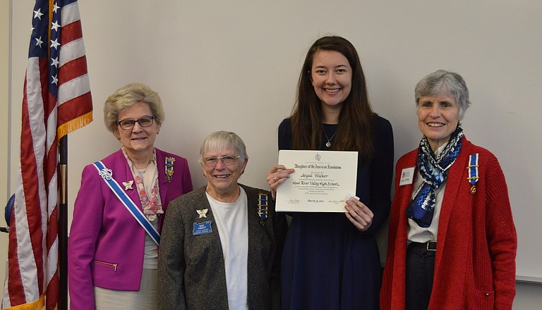From left, Alice Miles, Oregon State Society Regent DAR, Mary Parrott, Celilo Chapter Regent, and Vicki Kelsey, Good Citizenship committee chairman, present award winner Abby Walker with her certificate at the March 15 meeting.