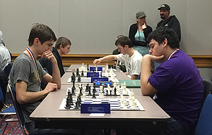 Noah Holloran, the top local finisher at the recent state chess competition, faces off against Oscar Galdamez of Hermiston High School. Holloran went on to tie for fourth among all high school competitors.
