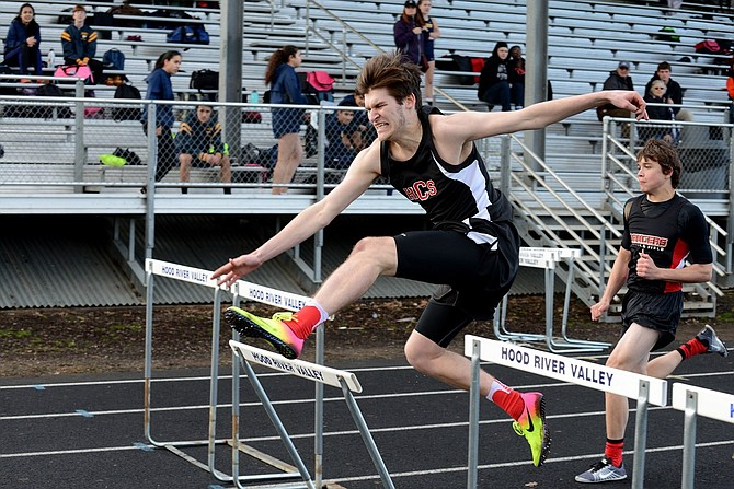 HORIZON TRACK AND FIELD ATHLETES competed at a meet in Hood River Wednesday. Above, Luke Holste in the 110-meter high hurdles.