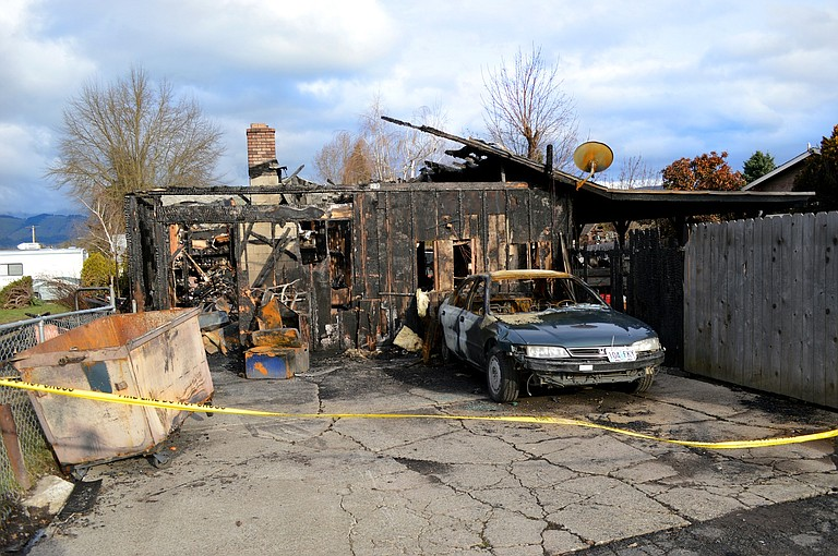 A CHARRED HOME remains after a fire broke out in the garage of an Odell house early Sunday morning. Fire crews doused the blaze within hours — and no one was injured — but the fire took a heavy toll with property damage. Fire officials say the cause is under investigation.