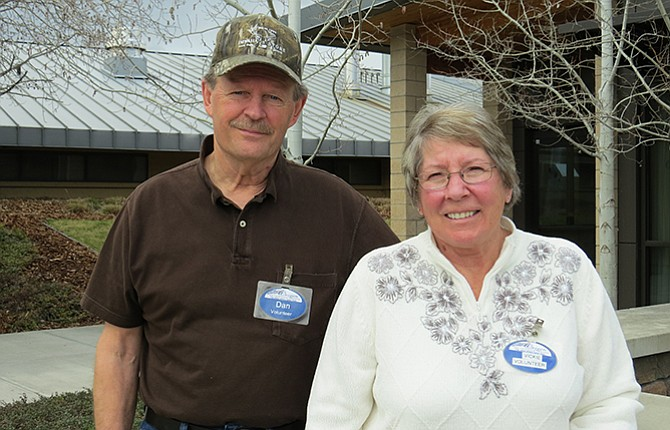 "Dan and Vickie Brindell, left, urge community members to join them in volunteering at ""The Place Where Honor Lives"" and have some fun while getting to know residents of the Oregon Veterans' Home."
