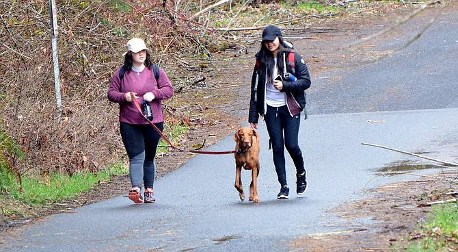 HIKERS return from Eagle Creek Trail on a misty Wednesday afternoon. Search and rescue efforts have challenged local crews this spring as visitors enjoy scenic Gorge and Mount Hood trails.