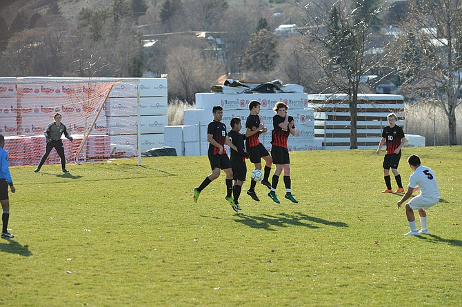 Omak players fearlessly put up a wall that stops a penalty kick by Okanogan's Josue Ramo. Omak players (from left) are Alfonso Medina-Martinez, Uriel Cruz, Dillon Carlton, Nico Avena and Patrick Ramey.