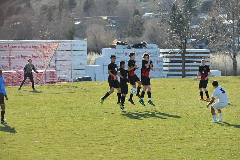Omak players fearlessly put up a wall that stops a penalty kick by Okanogan's Josue Ramo. Omak players (from left) are Alfonso Medina-Martinez, Uriel Cruz, Dillon Carlton, Nico Avena and Patrick Ramey.