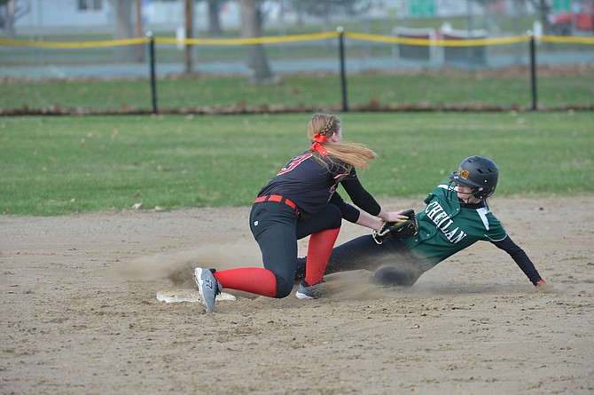 Taylor George tags out a Chelan runner in first game of a doubleheader Saturday.
