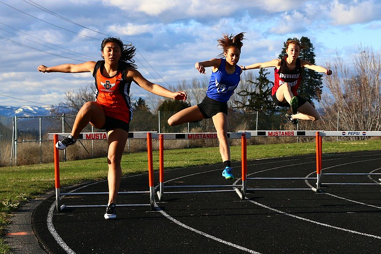 Leslie Velasco of Bridgeport (left) leads the 300-meter hurdles over Soap Lake's Marina Obzhylova, middle, and Omak's Cassidy Gates. Results for the meet were not published online at www.athletic.net/TrackAndField/.
