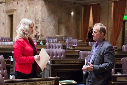 Rep. Jacqulin Maycumber (left), R-Republic, confers with Rep. John Koster, R-Arlington. They are co-sponsoring a bill to address property values affected by the Hirst water decision.