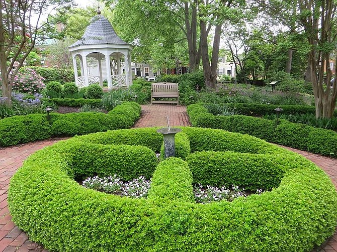 If you're planning a trip to Washington, D.C., consider staying across the Potomac River in Alexandria, Virginia, where you can see sites such as the formal gardens at the Carlyle House.