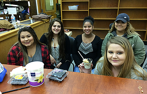From left, the students who are running the Wahtonka Community School Store are: Raquel Garcia, Sonia Sedano, Katy Barlow, Michelle Woolsey, holding a yogurt parfait, a top seller at the store, and Graceila Alvarez.