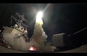 In this image provided by the U.S. Navy, the guided-missile destroyer USS Porter (DDG 78) launches a tomahawk land attack missile in the Mediterranean Sea April 7.  The United States blasted a Syrian air base with a barrage of cruise missiles in fiery retaliation for this week's gruesome chemical weapons attack against civilians.