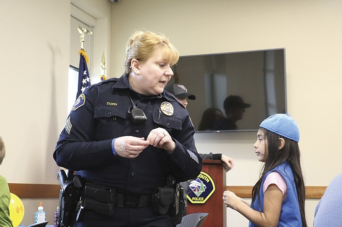 Sgt. Kim Dorn talks with Isabel Esparza during Craft with a Cop on April 5. 