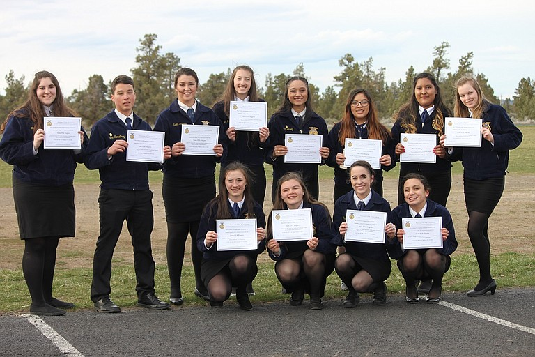 FFA MEMBERS at State in Redmond: standing, from left to right, are Megan Eshleman-Landry, Eric Santa Cruz, Kaylin Winans, Hannah McNerney, Beatriz Galvez, Maria Garcia-Toche, Jazmin Palacios, and Laney Erikson; front row, from left, Linsey Back, Natasha Muenzer, Jazlinn Fisher, and Courtney Castaneda. Not pictured, Georgia Mason and McKenzie Snyder.