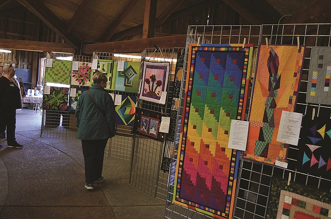 Colorful quilts line the walls of the Floral Building during last year's Blossom Craft and Quilt Show.