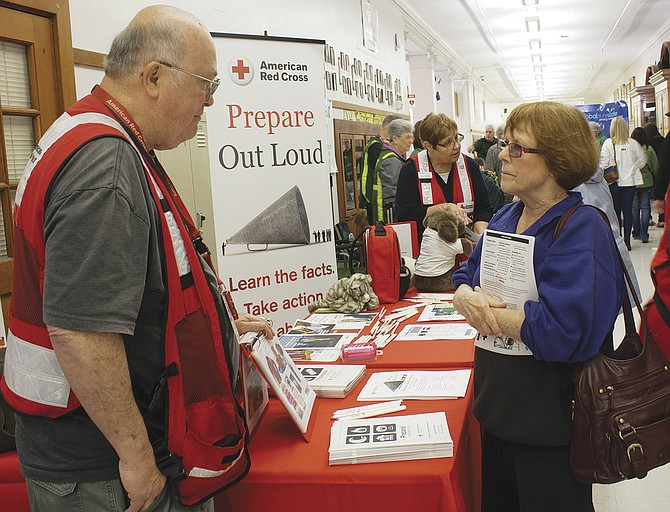 Representatives of the American Red Cross give preparedness advice to people at the Community Prepare Fair in Salem on Saturday, April 8.