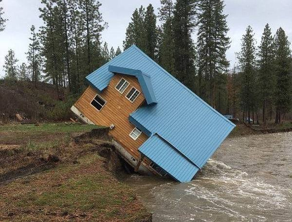 A house near Keller slips into the San Poil River in Ferry County earlier this week due to an eroding bank.