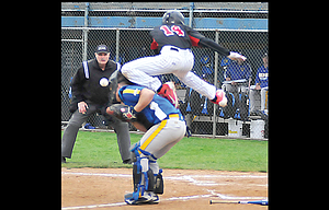Dufur Ranger Tabor McLaughlin, 14, hurdles the Heppner catcher to score a run in Tuesday's doubleheader. Dufur swept two games, 9-2 and 10-0.