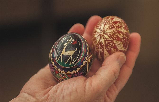 Karen Stewart of The Dalles holds a pair of Easter eggs decorated in the Ukrainian style by her aunt, Pauline Lencz. The yolk and white of the raw eggs have been removed, and melted wax used with a type of stylus is applied to create the design, which is worked from light colors to dark. When the decoration is complete, the wax is melted off. A variety of Easter activities are planned this weekend.