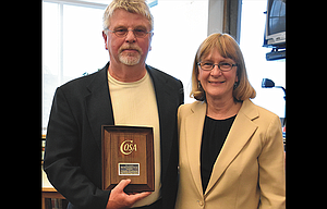 The Dalles High School Principal Nick Nelson received the Confederation of Oregon School Administrators High School Principal of the Year award Thursday. With him is District Superintendent Candy Armstrong, who nominated him for the award.