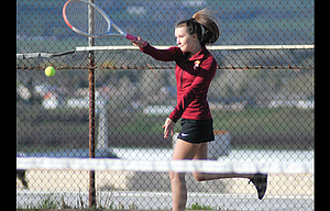 The Dalles tennis player Abby Minnick laces a forehand return in her No. 1 doubles match played Thursday at The Dalles HighSchool. Minnick and her partner, Ellie Trujillo, won their match in straight sets to help the Lady Hawks to a 4-4 tie against Pendleton. Robin Pashek, Kiana Pielli and Yahaira Alvarez scratched across wins on the singles side.