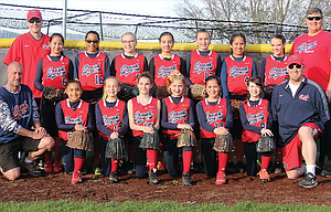 Cherry City Crush 12U players and coaches bring a wealth of championship experience and top play to the table this spring for action in a new 'B' classification. In the photo are, in the front row, from left to right, coach David Jones, Jeilane Stewart, Ella Smith, Ashlyn Jones, Zoe LeBreton, Keiliani Crichton-Tunai, Lilly Schatz, and Manager Ryan LeBreton. In the back row are, from left, coach Jeff Smith, Kaleyah Crichton-Tunai, Amyrah Hill, Sierra Faulkner, Naomi Heredia, Kennedy Abbas, Dominique Mausolf, Alicia Anderson, and coach Joe Abbas. The team plays on April 29-30 in Selah, Wash.