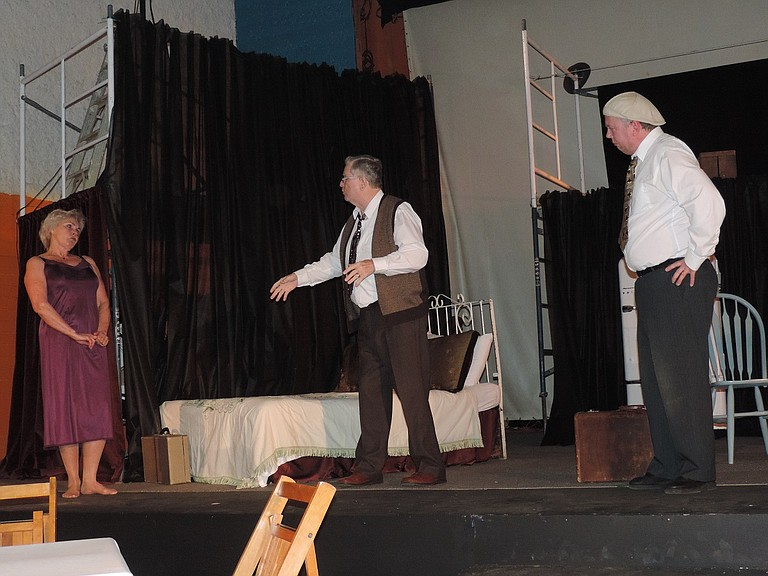 """Biff Loman (David Dye, right) makes a crushing discovery in """"Death of a Salesman,"""" encountering his father, Willy (Tom Burns) and The Woman (Brenda Hering)."""