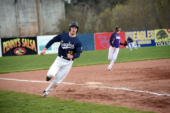 CONNOR COERPER (above) rounds third base on his way to scoring a run during the second game of Friday's doubleheader against Hermiston in Hood River.