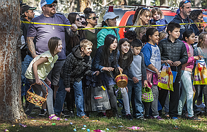 Kids keep an alert eye on the Easter Bunny as they prepare for a mad scramble during the 16th annual Griffith Motors/Bicoastal Media Easter Egg Scramble Saturday at Sorosis Park. The scramble was presented by A Kidz Dental Zone, Cascade Square Merchants, and Columbia Gorge Affordable Homes. Candy was provided through the support of Grocery Outlet, Papa Murphy's Pizza, Northern Wasco County PUD, Canton Wok, Cascade Orthopedics, NAPA Auto Parts in The Dalles, Casa El Mirador, Fred Meyer, McDonald's, Debra Klaviter Farmers Insurance, and CH2M Hill.