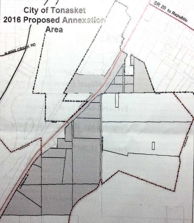 Gray shading indicates the proposed annexation area south of the city limits, east of Highway 97, and west of Longanecker Road, and the county shop property lying west of Highway 97.