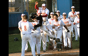 The Dalles junior Henry Lee is mobbed by his teammates after slugging a walk-off two-run home run in the bottom of the sixth inning in the riverhawks' 17-7 mercy-ruled triumph over Pendleton. Jose Gonzalez had three hits and finished a home run shy of the cycle and picked up the decision on the mound. In all, TD pounded out 16 hits.