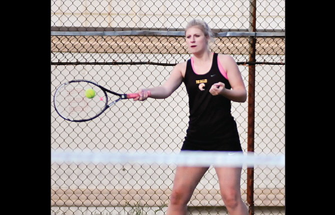 The Dalles tennis player Ellie Trujillo returns a volley during her doubles match. Trujillo and the Riverhawks ended up losing by a 6-2 score against Hood River.
