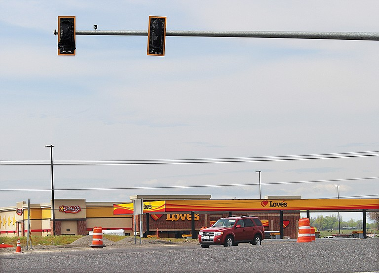New traffic lights went up yesterday at the intersection of Wine Country, Gap and Merlot roads in Prosser near the Interstate 82 interchange. The new lights were installed as part of a new Love's truck stop and Carl's Jr. project being built.